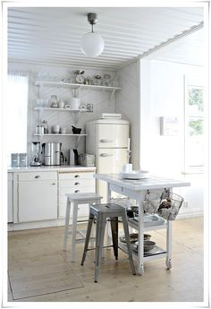 all white and off-white kitchen. oh my lord that FRIDGE