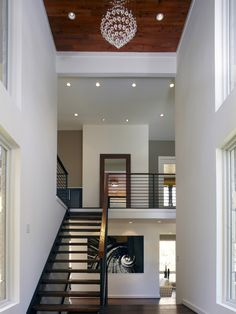 Floating Staircases Design, Pictures, Remodel, Love the darker wood ceiling and the modern chandelier!  I hope that lowers for cleaning.
