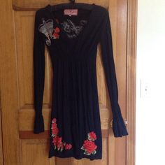 Johnny Was embroidered black dress Very cool rock and roll dress with embroidered roses front and back. Embroidered Rock and Revolution on the back. Long sleeves with elastic and flared cuffs. Elastic waist. Length is approx 24 inches depending on wear the elastic waist sits. Johnny Was Dresses