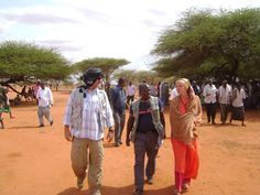 UN Volunteer Birgitt Hotz meets with the Dir clan and its clan elders to discuss humanitarian needs and the problems they face due to marginalization in Huurshe, central Somalia. Here, she prepares for the meeting with UN Volunteer Samual Jeddy, middle, and UNDSS security officer Robert Marinovic, left. (UNV, 2011)