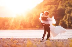 Just Married Couple Spinning on Beach Riverside Background by MarkUmbrella