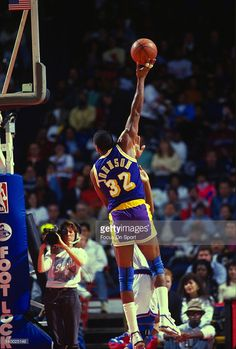 Earvin Magic Johnson #32 of the Los Angeles Lakers shoots a hook shot over a Washington Bullets defender during an NBA basketball game circa 1989 at the Capital Center in Landover, Maryland. Johnson played for the Lakers from 1979 - 91, 96.