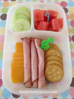 Ham, cheese, crackers lunchables. cheddar cheese, nitrate free ham roll ups, whole wheat crackers, cucumber slices and watermelon chunks.