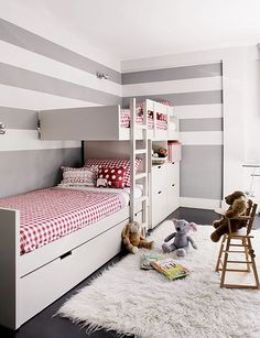 Offset bunk beds, grey and white striped walls