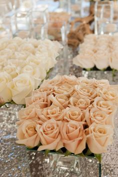 Mirrored vases with rows of short stem roses... So clean & classic!