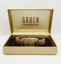 This is a handsome estate found vintage Gruen  Curvex wristwatch dating to the 1950s/60s. The curved 14K gold rectangular case frames a silver tone dial with Arabic numerals. The hand wound 17 jewel movement is unadjusted. The watch is accompanied by the original box.     Condition: In overall good but in need of some restoration. Wear and losses to the finish on the dial as pictured. There are scratches to the crystal and a few flakes to the edges. The watch winds, runs, and keeps good ...