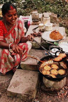 The next time I feel like complaining about my small kitchen I will look at this picture. And this happy woman who cooks on cement blocks.