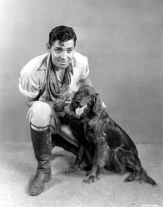 Clark Gable with his new pet, the Irish setter Queen