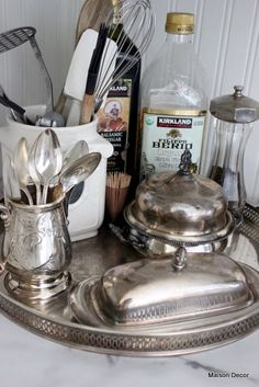 Decorating with Silver - great post on ways to use your silver collection - Amy Chalmers, via Maison Decor 8