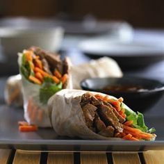 BEEF SPRING ROLLS WITH CARROTS AND CILANTRO: Makes (4) Servings. Marinade time 30 minutes to 2 hours. Total recipe time: 25 to 30 minutes.