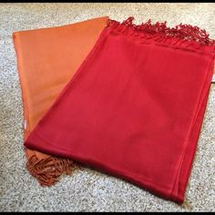 """Lot of 2 rust & red scarves This lot of 2 scarves are both identical. The rust one I cut the tag off. They have only been worn a couple of times. The second pic reflects a couple snags. This is reflected in the price. The are 28"""" x 79"""" plus the fringe. Purchased at Macy's. No need to dry clean. Just was/dry on delicate and iron when a little damp. Unknown Accessories Scarves & Wraps"""
