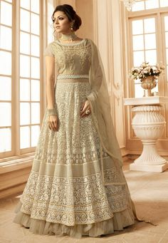 Semi-stitched Net and Art Silk Layered Abaya Style Kameez in Light Beige This Round Neck and Short Sleeve attire with Poly Shantoon Lining is Prettified with Resham, Zari, Stone and Patch Border Work Available with a Light Beige Poly Shantoon Churidar and a Light Beige Net Dupatta The Kameez and Bottom Lengths are 52 and 48 inches respectively Do note: The Length may vary upto 2 inches. Accessories shown in the image are for presentation purposes only.(Slight variation in actual color vs…
