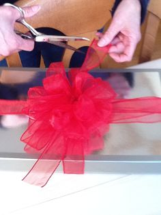 you can also use the ribbon that you have wrapped around the present to tie around the center of the loops.that way you won't have to use pipe cleaner Christmas Time, Christmas Crafts, Christmas Decorations, Holiday Decorating, Christmas Ideas, Decorating Ideas, Cute Crafts, Diy Crafts, Making A Bouquet