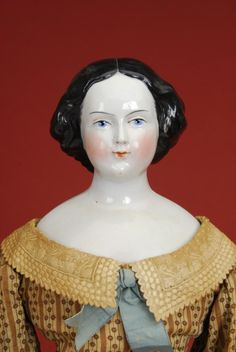 China Doll; German, Lady, Blue Painted Eyes, Molded Black Jenny Lind Hair with Bun, 26 inch.