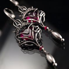 Fully handmade work: necklace technique: wire-wrapping materials: sterling silver, fine silver , 18 Ct yellow gold , labradorite , ruby , purple turquoise , obsidian, labradorite ,onyx and spi...
