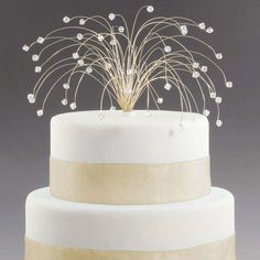 "Fourth of July or New Year's wedding?  Celebrate the holiday with a fireworks-inspired wedding cake topper. Gold wires seemingly ""explode"" from the top with tiny crystals on each wire's end."