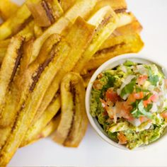 Healthy take on a traditional Mexican appetizer. The only guacamole you will ever need to make again paired with healthy homemade Plantain ribbons. Everyone will love!