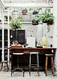 I love the dark wood benches and the stools