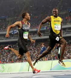 Andre De Grasse, left, and Jamaica's Usain Bolt smile at each other in a men's 200-meter semifinal, during the athletics competitions of the 2016 Summer Olympics at the Olympic stadium in Rio de Janeiro, Brazil, Wednesday, Aug. 17, 2016. (AP Photo/Matt Dunham)