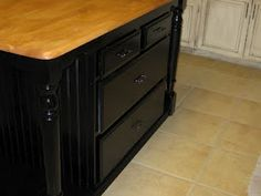 Old dresser and old kitchen table combined into a kitchen island