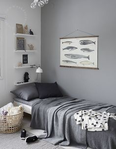 A simple grey bedroom, great for guest bedrooms. Mix the tones of grey paint used to create a bit of light in the room.