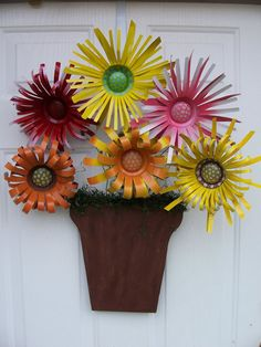 Flowers out of aluminum cans!! I am so making this!