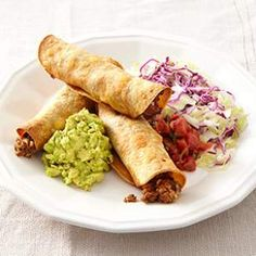 OVEN-FRIED BEEF TAQUITOS     1 medium zucchini     2 teaspoons canola oil     1 pound extra-lean ground beef     3 tablespoons chili powder     2 teaspoons onion powder     1 teaspoon ground cumin     1/2 teaspoon salt     12 6-inch corn tortillas     Canola oil cooking spray     3/4 cup shredded sharp Cheddar cheese