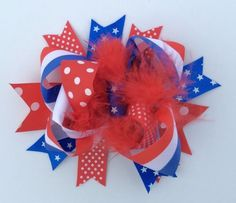 """The July 4th 6"""" Korker Marabou feather hair bow for little girls is a perfect match to our July 4th outfits and dresses. It has tons of layers of top quality red, white, and blue ribbon with stripes a"""