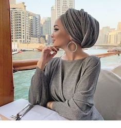 Image may contain: 1 person, sitting, table and outdoor Turban Hijab, Turban Mode, Turban Outfit, Modern Hijab Fashion, Muslim Fashion, Modest Fashion, Mode Outfits, Chic Outfits, Head Scarf Styles