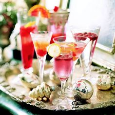 Use a vintage metal serving tray to serve colorful cocktail drinks, and surround the glasses with silver and gold ornament balls for the perfect holiday party touch! http://www.bhg.com/christmas/parties/holiday-buffet-serving-tips/?socsrc=bhgpin123114cocktailservinjgtray&page=19