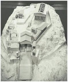 A model of the Acropolis in Athens, as it would have appeared in ancient times, with the Parthenon surrounded by lesser buildings and temples.