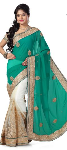 152482: Green, White and Off White color family Saree with matching unstitched blouse.