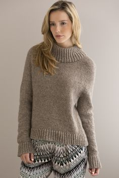 Essence Pullover in TAHOE A deeply-ribbed collar, cuffs and hem transform this simple pullover. It's the perfect easy-to-knit, cozy sweater for a chilly day. Available in sizes Small (Medium, Large, XL, 2X, 3X)