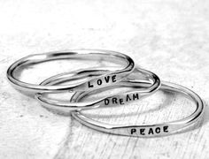 Tiny Stacking Posey Ring - custom made ring with your word choice in sterling silver by Kathryn Riechert (Tiny Text). $22.00, via Etsy.