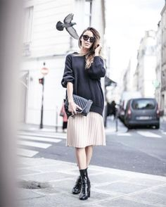 Pair a pleated midi skirt with an oversized sweater and patent...