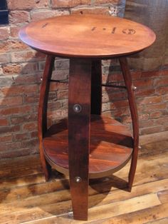 """Large bistro table made from wine barrels.  Choose from 6 different finishes. Measures 35""""h x 23""""w x 23""""d.   This American made Bistro table is made from California wine barrels.  It features an authentic, branded barrel top head, stave legs, and a hand forged wrought iron cross and support ring.  Top dimensions may vary slightly. Ships fully assembled. Please note, these items are made from used wine barrels, each stave will accept stain differently. Www.puravidahomedecor.com"""