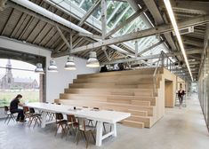 Bleacher-style seats conceal private offices, toilets and storage areas inside this advertising agency created by Dutch office Bedaux de Brouwer Architecten