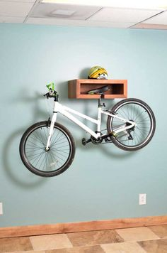 Handmade Wooden Bike Rack & Shelf - This unique architectural bike rack is hand crafted out of mahogany. It is beautiful with and without your bike docked in it. This piece also doubles as a shelf for displaying your favorite items. Perfect for the outdoor lover who wants to bring his/her toys inside without losing the beauty of home.  www.GonnaWannaGetit.com
