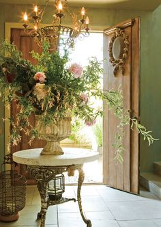 outdoor table and floral arrangement similar to the idea i am forming for the space under the stairs in the entry foyer i see the foyer with brick floor