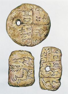 ROMANIA - DECEMBER 29: Terracotta Tartaria tablets, with incised Vinca symbols…