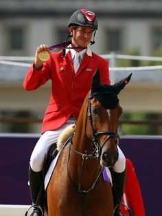 Steve Guerdat of Switzerland wins gold riding Nino Des Buissonnets in the Individual Jumping