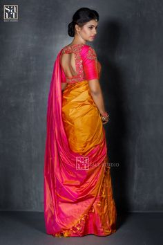 Behold the beauty of this mustard and pink plain  Kancheevaram colour block  saree that s paired with a heavy  embroidery blouse. Catching your breath  are you