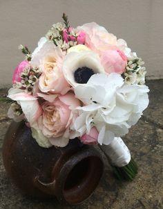 Beautiful selection of flowers including David Austin Kiera roses, hydrangea, anemones and ranunculus