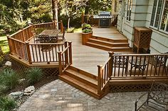 Decks - Wood and Composite Materials     Decks are typically, but not always, attached to the back or side of a house. They are designed to work with the elevations of the house access and the lay of the