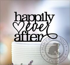 Our happily ever after cake topper will add a touch of fairy tale magic to your special day. Adorned with a heart, this cake topper will make