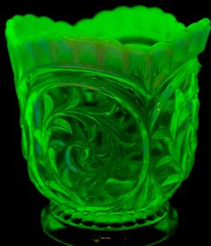 """Lot 77 in the 8.16.16 online & live auction! An elegant vintage pressed uranium glass vase / bowl with an opalescent rim. It glows bright green when placed under ultraviolet light. It is unmarked. Measures 4"""" tall and has a 4"""" diameter. Excellent condition, free of chips, breaks an repairs. #Decor #Home #ShopSmall #POGAuctions"""