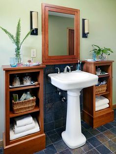 The open cabinets on either side of the pedestal sink might work in one of my miniscule bathrooms.