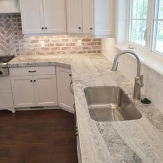 brick backsplash - yes please! Gray Quartzite Countertops with Stainless Steel Kitchen Sink