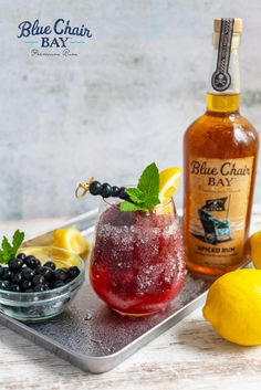 This spiced rum slush recipe uses fresh blueberries to make a delicious cocktail. Blend spiced rum, blueberries, lemons, and honey in a blender with ice. Pour into a glass and top with lemon soda. #bluechairbay #spicedrum #BCBHappyHour