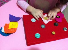 Button Boards We have a new activity! It's a quiet activity that we keep with our books for quiet time. I pinned a Button Board idea and thought I'd make one for Butterfly to use. It's great for fine motor finger strengthening skills and to learn more of the buttoning skills for clothing practice, plus it reviews the basic shapes.